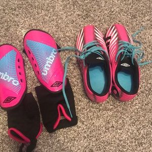 Girls soccer shoes and knee pads. Size 11 shoes.